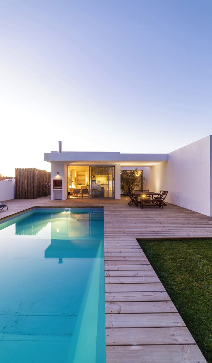 modern-house-with-garden-swimming-pool-and-wooden--P7NVS7C