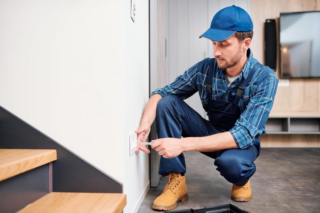 young-electrician-from-household-maintenance-servi-H5M4NQ7