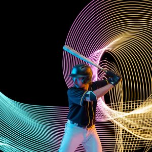 Creative sport on dark neon lighted line background. Baseball player training in action and motion on colorful waves. Concept of hobby, healthy lifestyle, youth, action, movement, modern style.