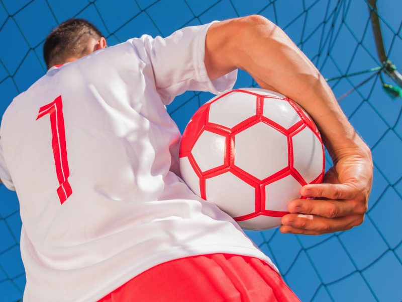 red-and-white-soccer-player-QJRBFPZ