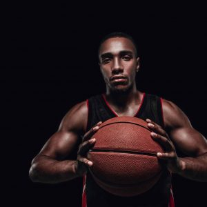 the-portrait-of-a-basketball-player-with-ball-P6BXQ9H