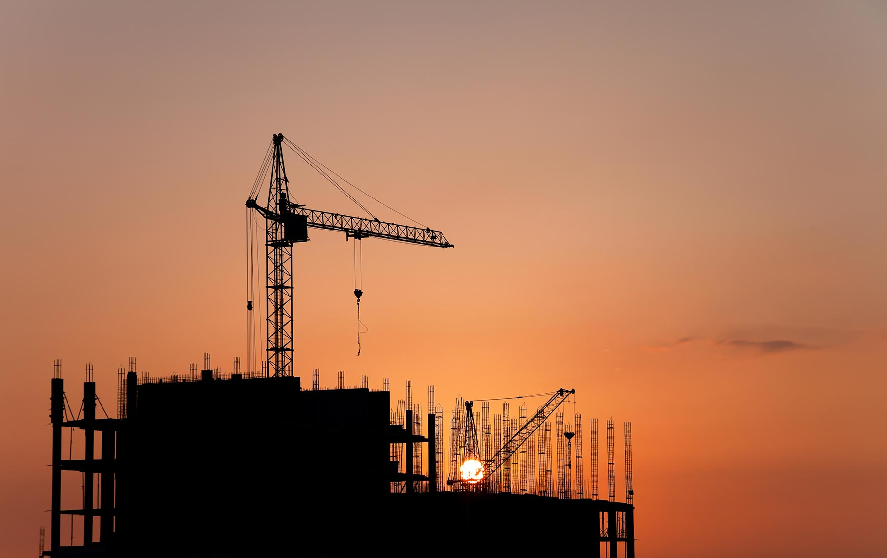 construction-cranes-and-concrete-structure-at-suns-PBLEVC8