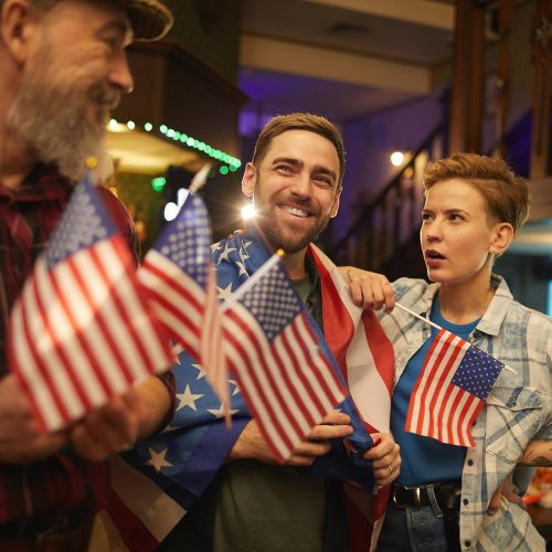 people-with-american-flags-in-the-bar-XCXLVJB