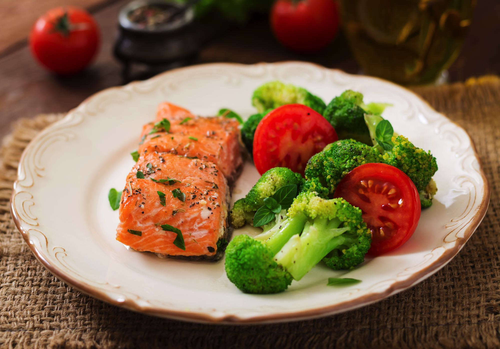 baked-fish-salmon-garnished-with-broccoli-and-toma-PBKGZRK
