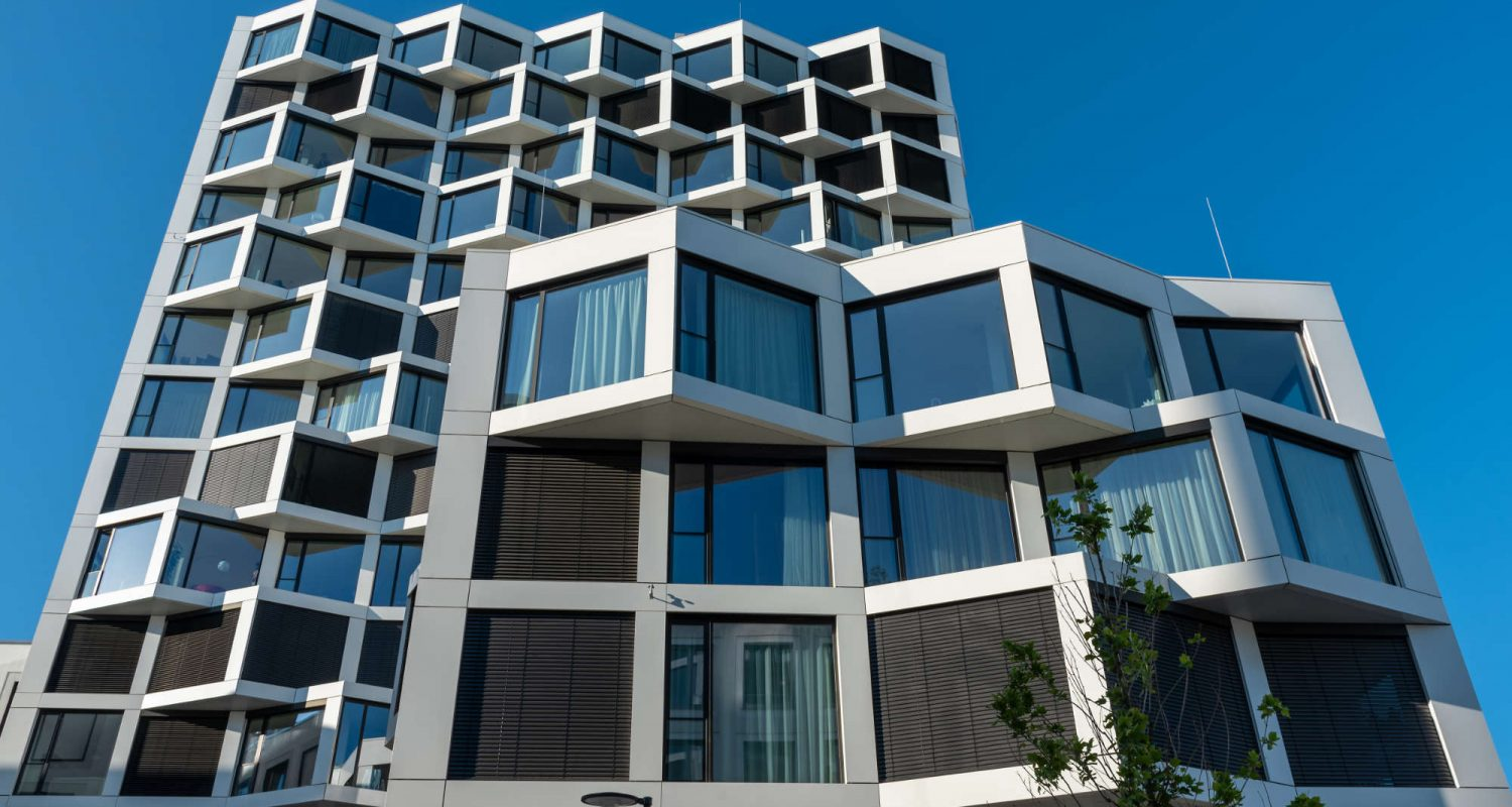 facade-of-modern-high-rise-residential-building-NPW7XTU