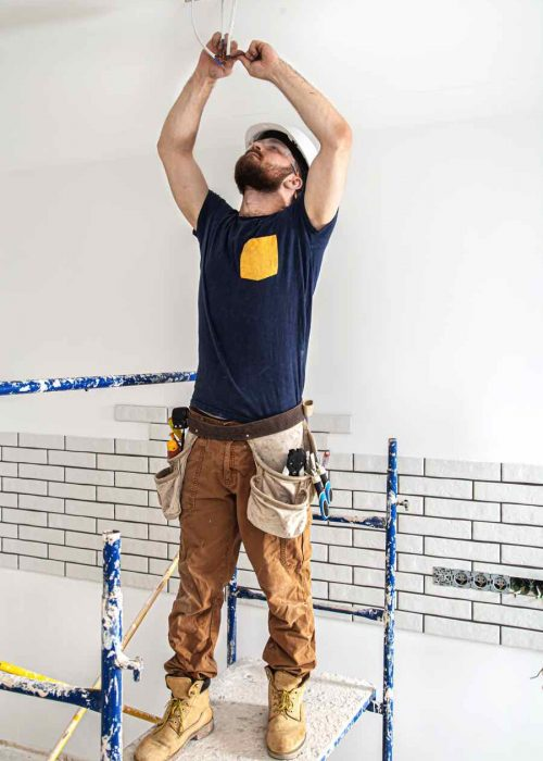 electrician-builder-at-work-installation-of-lamps--52CY9UP
