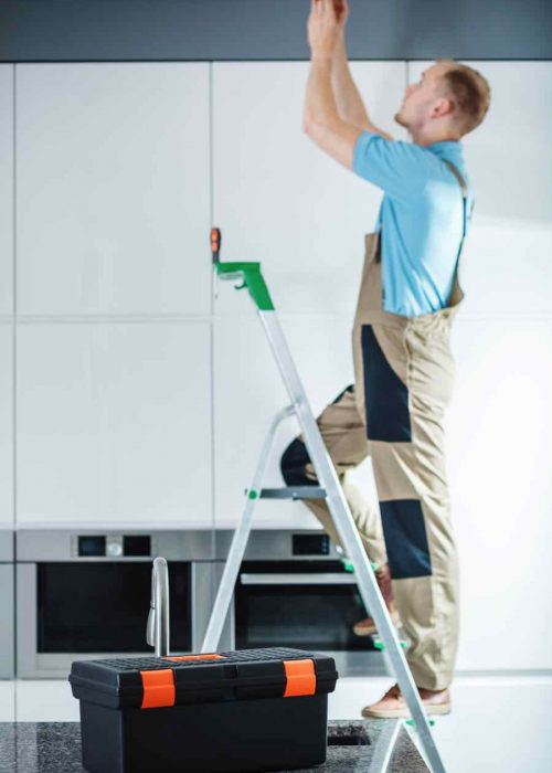 professional-electrician-on-ladder-PXJTP2G