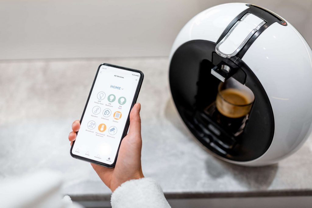 Cotrolling coffe machine with a smart phone, close-up on phone with launched smart home application
