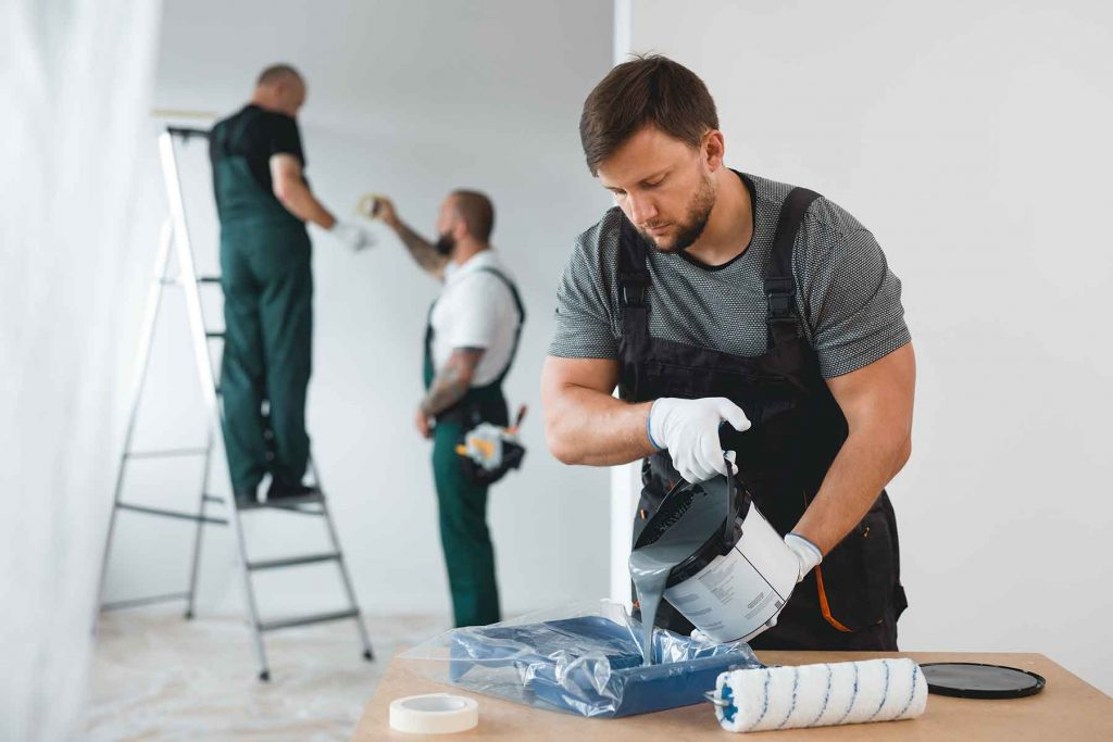 efficient-renovation-crew-painting-white-walls-of--JUV2CXE