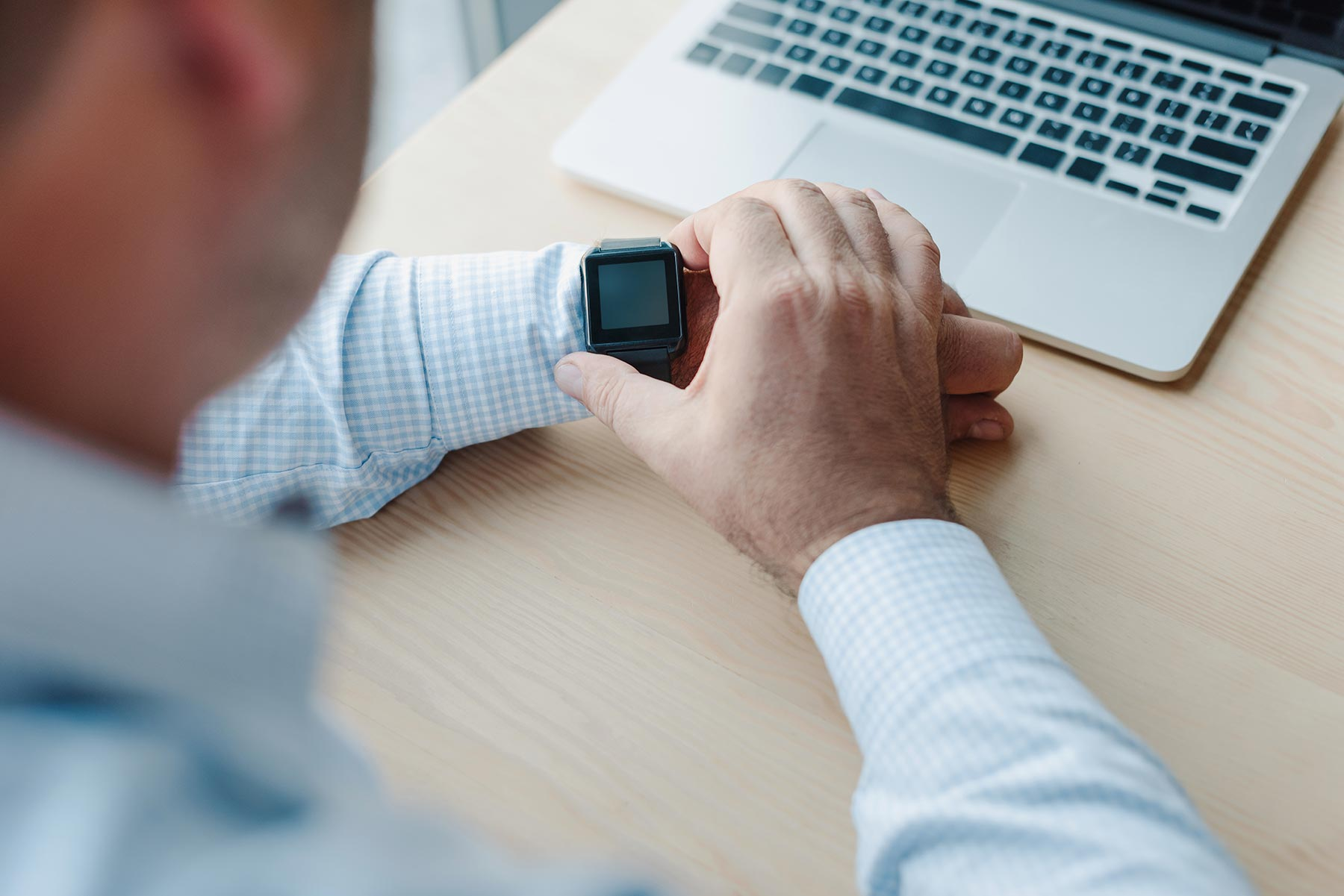 cropped-shot-of-businessman-checking-time-on-smart-6EGV9PY