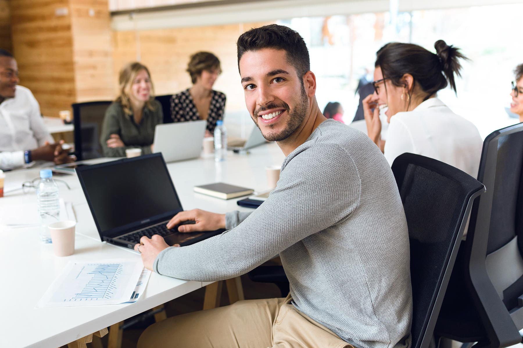 attractive-young-businessman-working-with-laptop-w-CLTWURQ