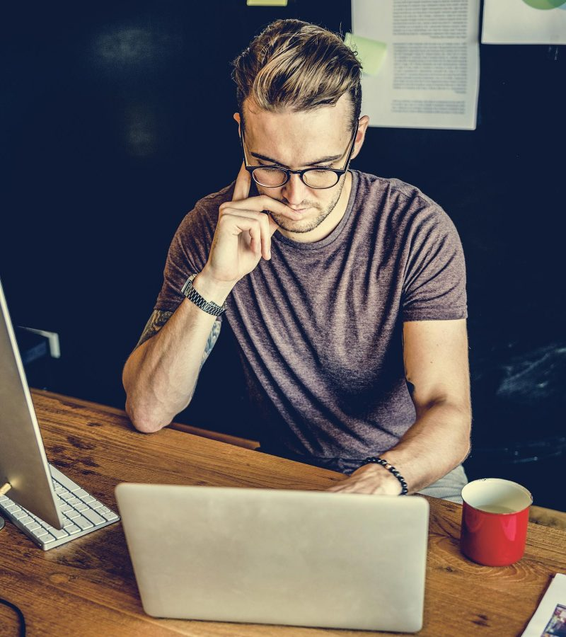 man-busy-photographer-editing-home-office-concept-PWSESWA